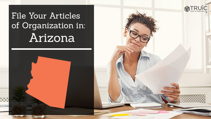 Woman smiling while looking at her articles of organization for Arizona.