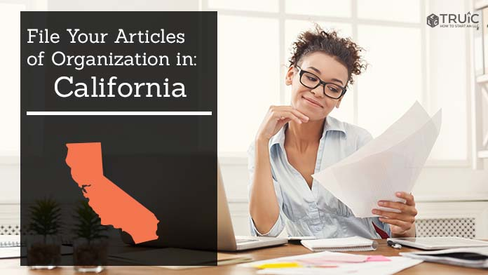 Woman smiling while looking at her articles of organization for California.