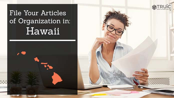 Woman smiling while looking at her articles of organization for Hawaii.