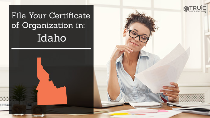 Woman smiling while looking at her articles of organization for Idaho.