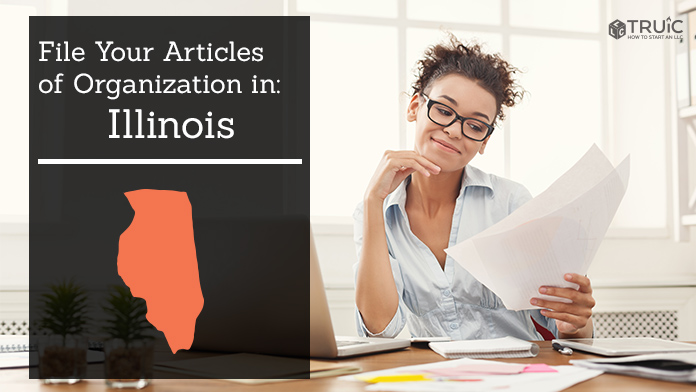 Woman smiling while looking at her articles of organization for Illinois.