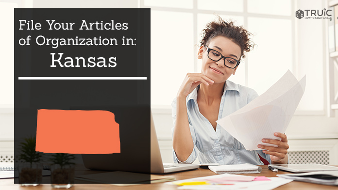 Woman smiling while looking at her articles of organization for Kansas.