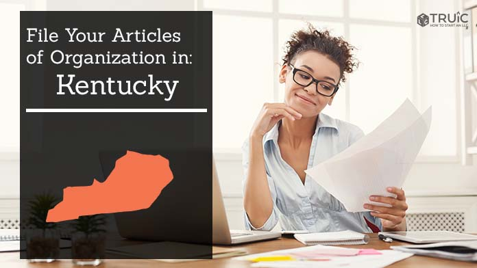 Woman smiling while looking at her articles of organization for Kentucky.