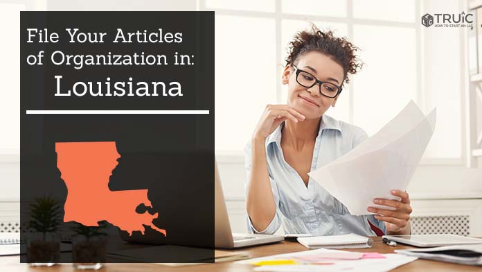 Woman smiling while looking at her articles of organization for Louisiana.