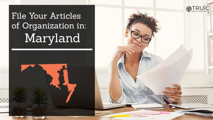 Woman smiling while looking at her articles of organization for Maryland.
