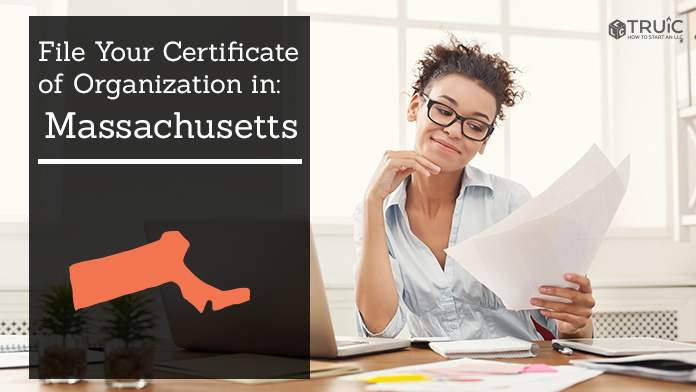 Woman smiling while looking at her certificate of organization for Massachusetts.