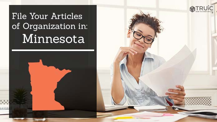 Woman smiling while looking at her articles of organization for Minnesota.