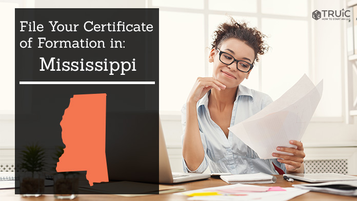 Woman smiling while looking at her articles of organization for Mississippi.