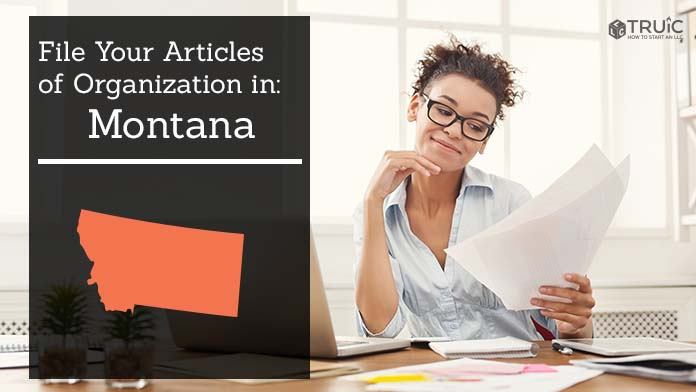 Woman smiling while looking at her articles of organization for Montana.