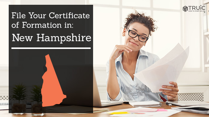 Woman smiling while looking at her articles of organization for New Hampshire.