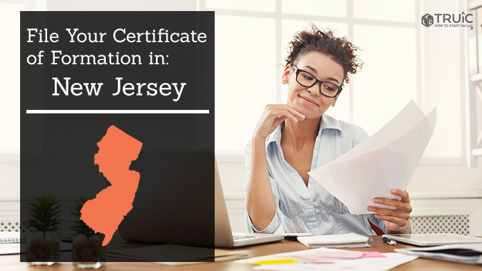 Woman smiling while looking at her certificate of formation for New Jersey.