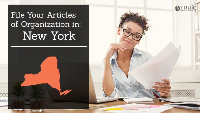 Woman smiling while looking at her articles of organization for New York.