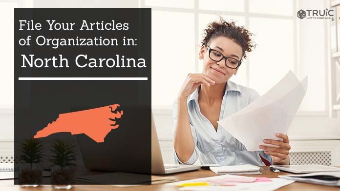 Woman smiling while looking at her articles of organization for North Carolina.