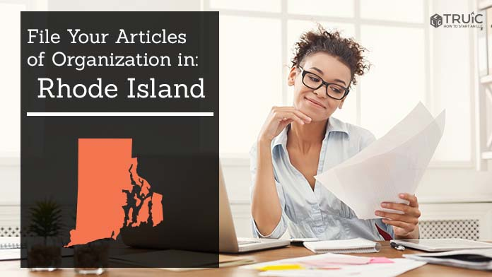 Woman smiling while looking at her articles of organization for Rhode Island.