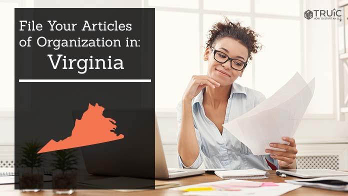 Woman smiling while looking at her articles of organization for Virginia.