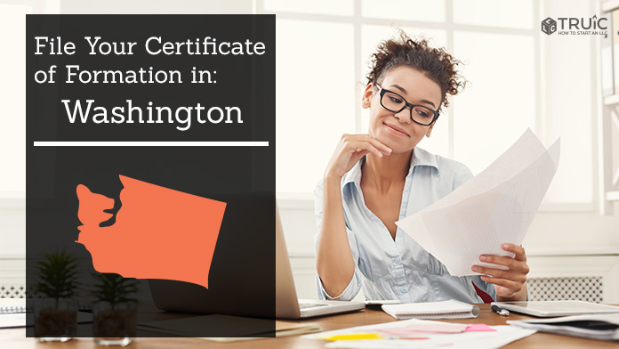 Woman smiling while looking at her Certificate of Formation for Washington.
