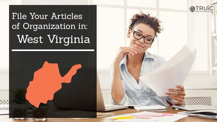 Woman smiling while looking at her articles of organization for West Virginia.