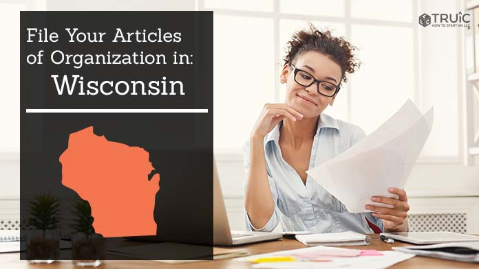 Woman smiling while looking at her articles of organization for Wisconsin.
