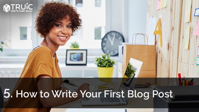 Woman writing her first blog post.