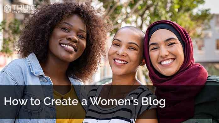 Three women smiling toward the camera