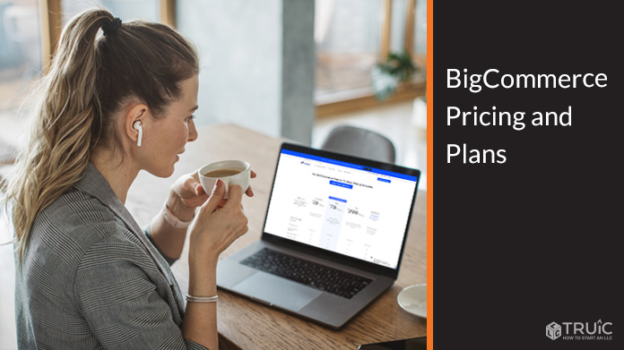 Person looking at a computer screen with BigCommerce pricing plans.