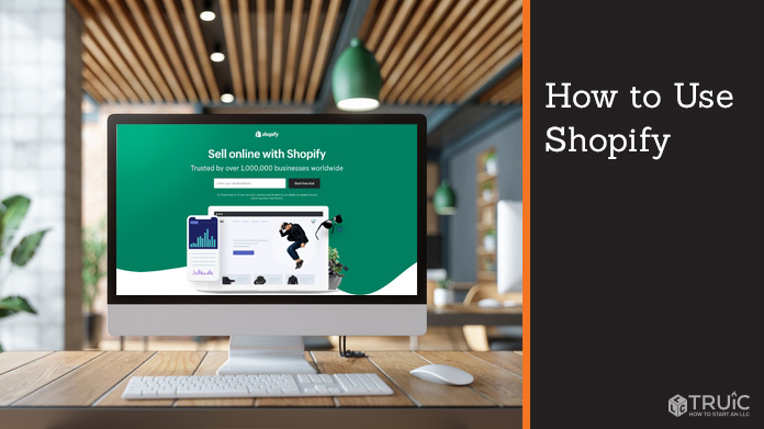 """Desktop with Shopify webpage that says, """"Sell online with Shopify."""""""