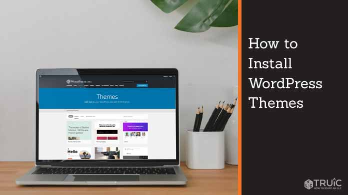 """Laptop with Wordpress webpage that says, """"Themes."""""""