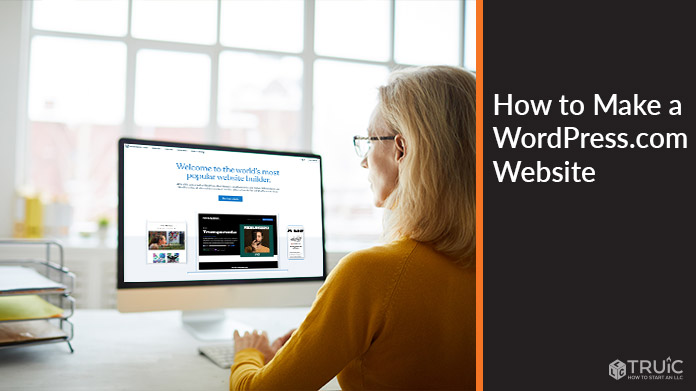 Woman working on computer with WordPress.com homepage on screen.
