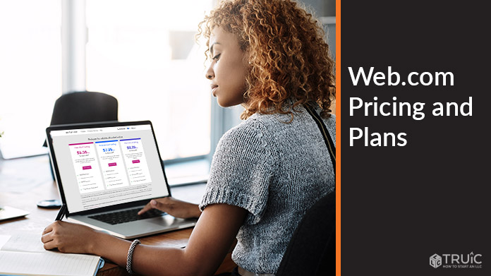 Woman working on computer with Web.com pricing on screen.