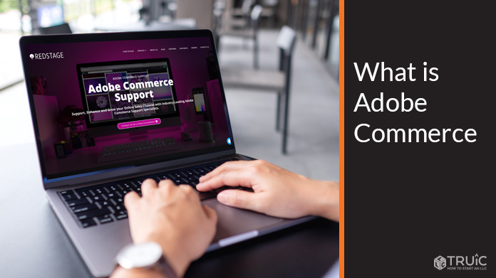 Man working on computer with Magento homepage on screen.