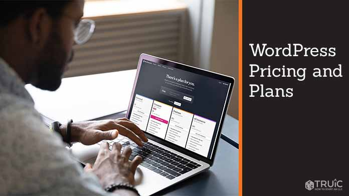 Man looking at WordPress plans and pricing on laptop.