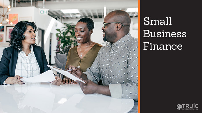 Couple with financial advisor going over financing for their small business.