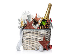 A gift basket containing champagne, pinecones, and a gift on a blank background