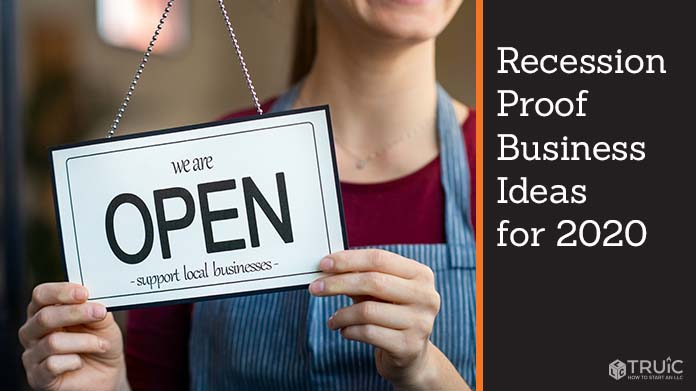 business owner smiling and holding open sign