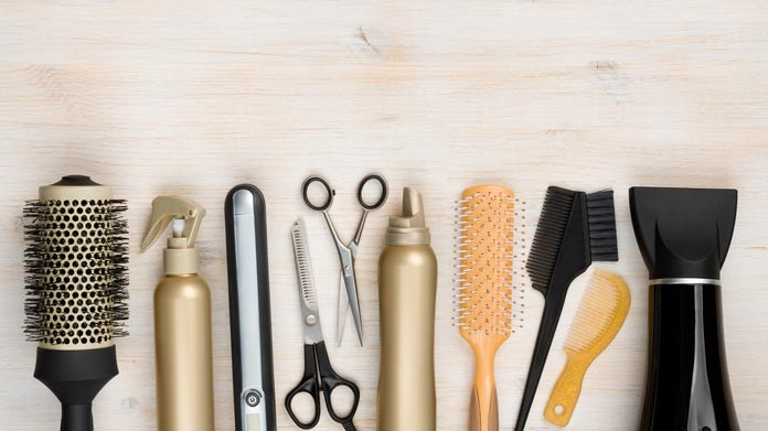 Image of brushes, scissors, and other hairdresser's tools