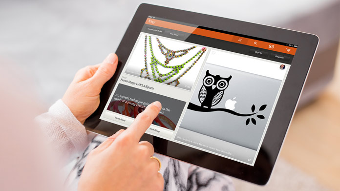 Close-up of someone with Etsy open on a tablet.