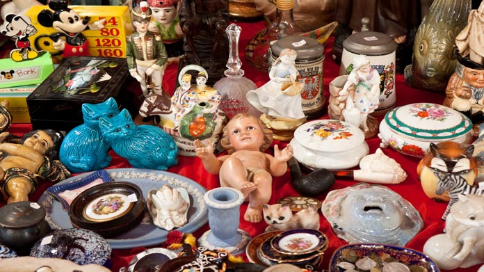 Image of table covered in old toys and other knick-knacks