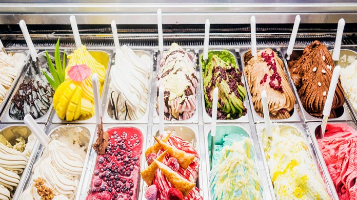A display case with different gelato flavors