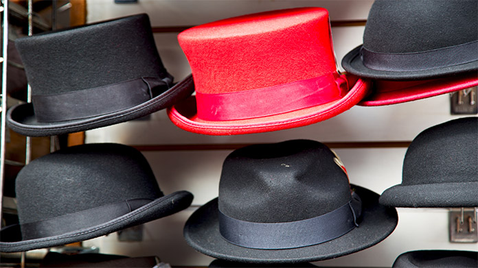 A shelf with different hats