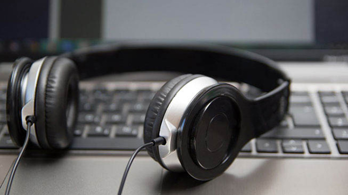A pair of headphones sitting on top of a laptop keyboard
