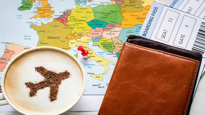 Image of map, airline ticket, and latte with airplane-shaped latte art