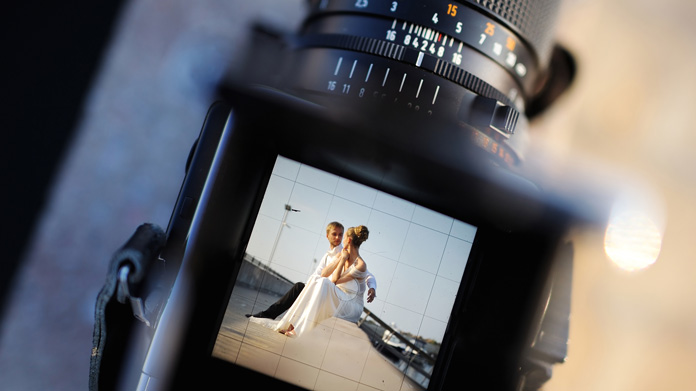 Photo of a married couple displayed on a camera screen