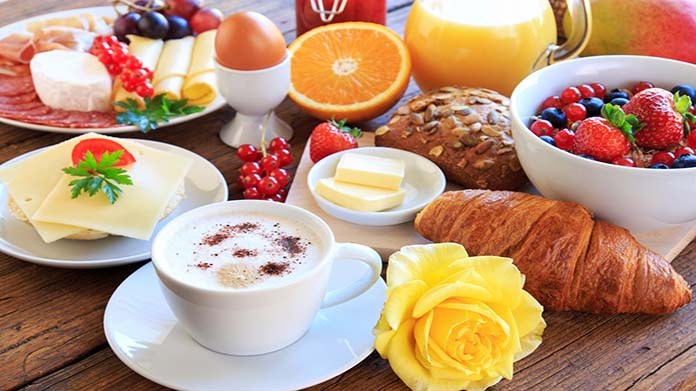 Bed and Breakfast Business Idea: A continental breakfast with fruit, a croissant, coffee, juice, and more