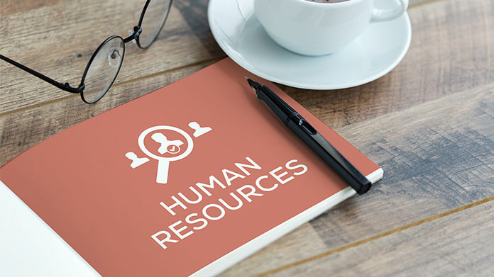 A book that says human resources on a table