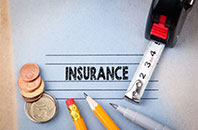 The word insurance on a document with business supplies surrounding it
