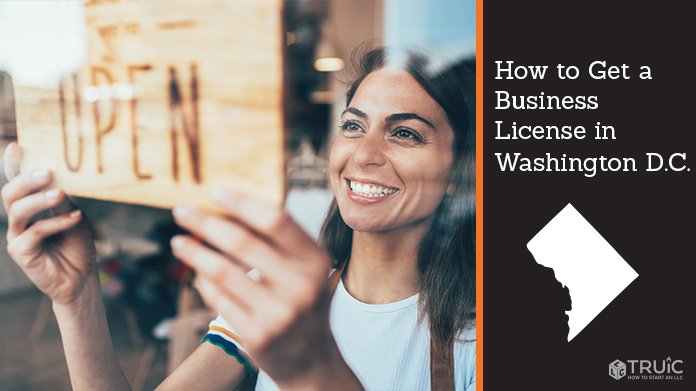 Woman holding open sign after getting her business license