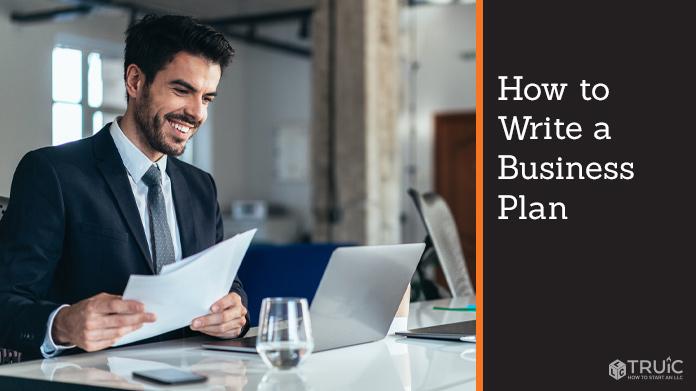Man writing a business plan.
