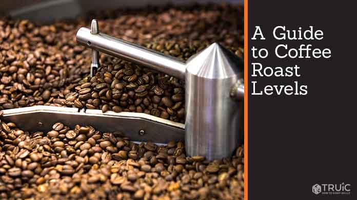 A coffee bean roaster filled with coffee beans.