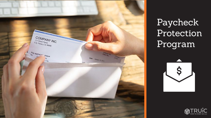 An entrepreneur opening a paycheck envelope