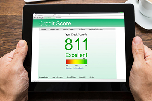 A tablet showing a credit score website and a score of 811